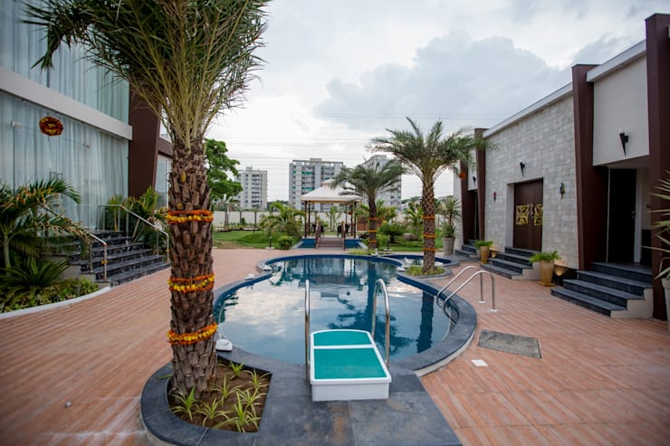 Swimming Pool:  Swimming pond by ZEAL Arch Designs