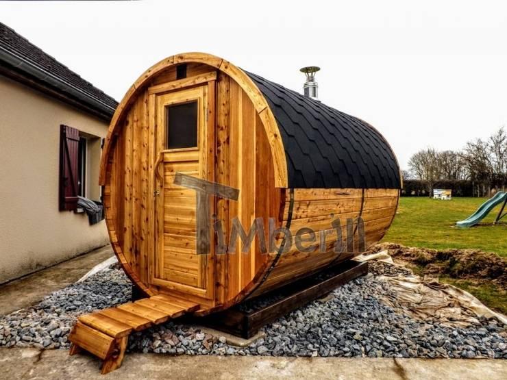 Outdoor – Buiten houten tuin sauna rond:  Spa door TimberIN hot tubs en sauna's