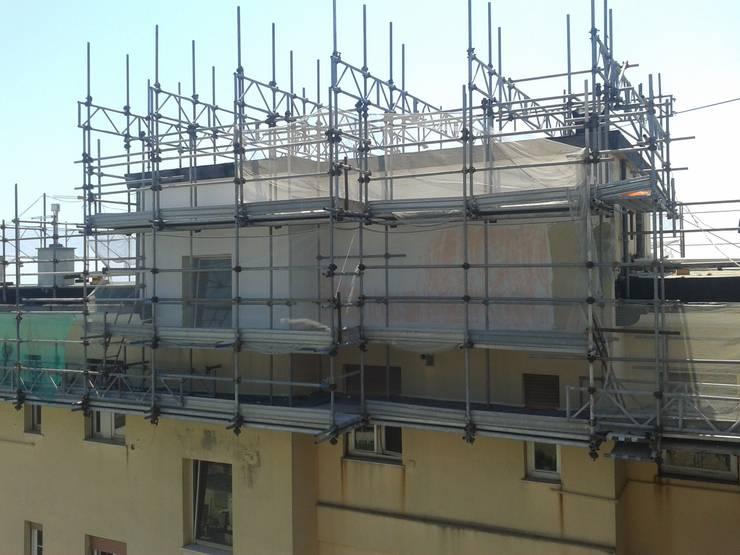 La rasatura armata: Condominio in stile  di Marcello Buffa Architetto