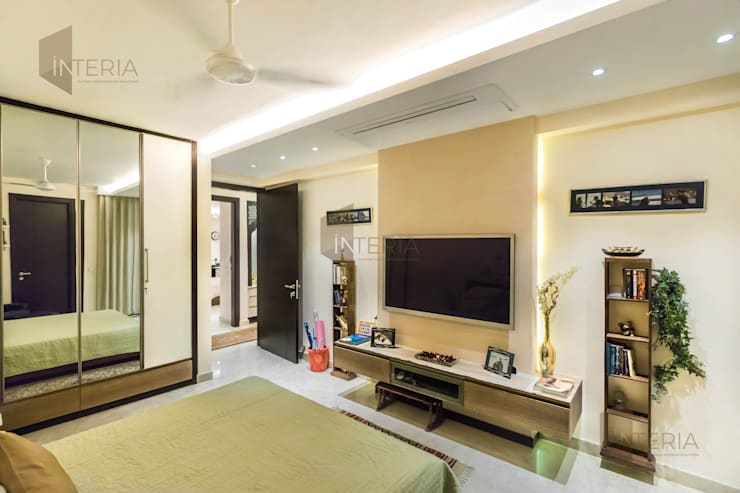 Ambience Lagoon:  Living room by UK Interia Pvt Ltd,Eclectic