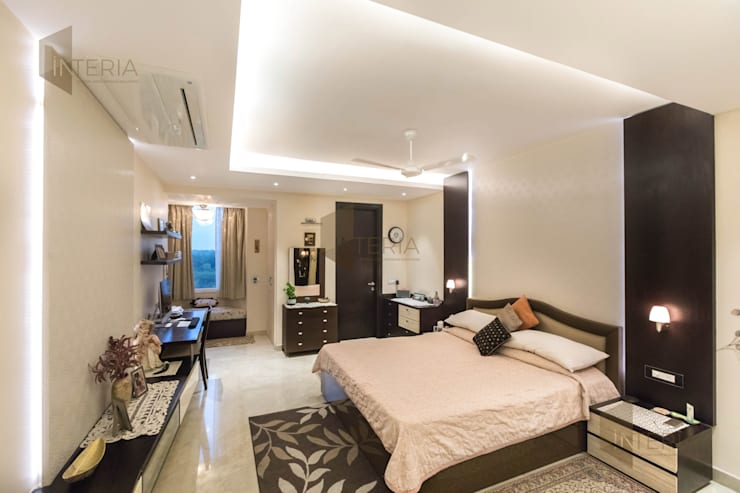Ambience Lagoon:  Bedroom by UK Interia Pvt Ltd,Eclectic
