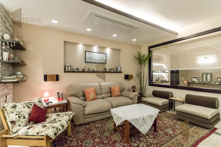 Ambience Lagoon:  Living room by UK Interia Pvt Ltd