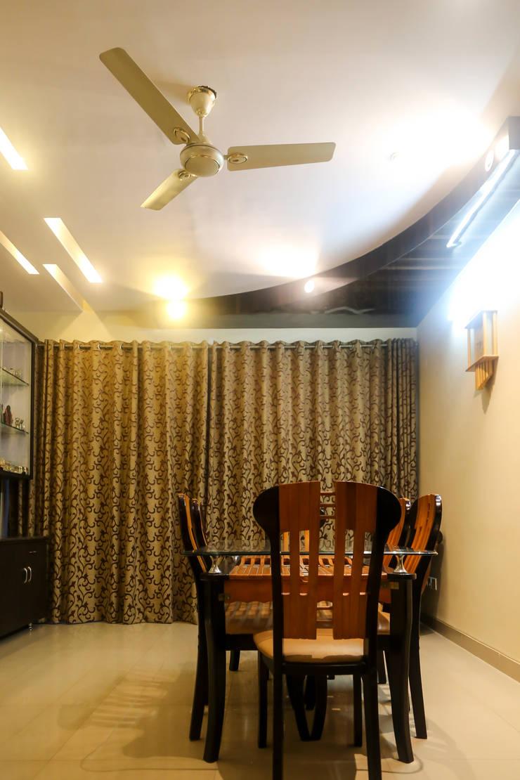Mr. Kishan InduFortuneCity:  Dining room by Ghar Ek Sapna Interiors