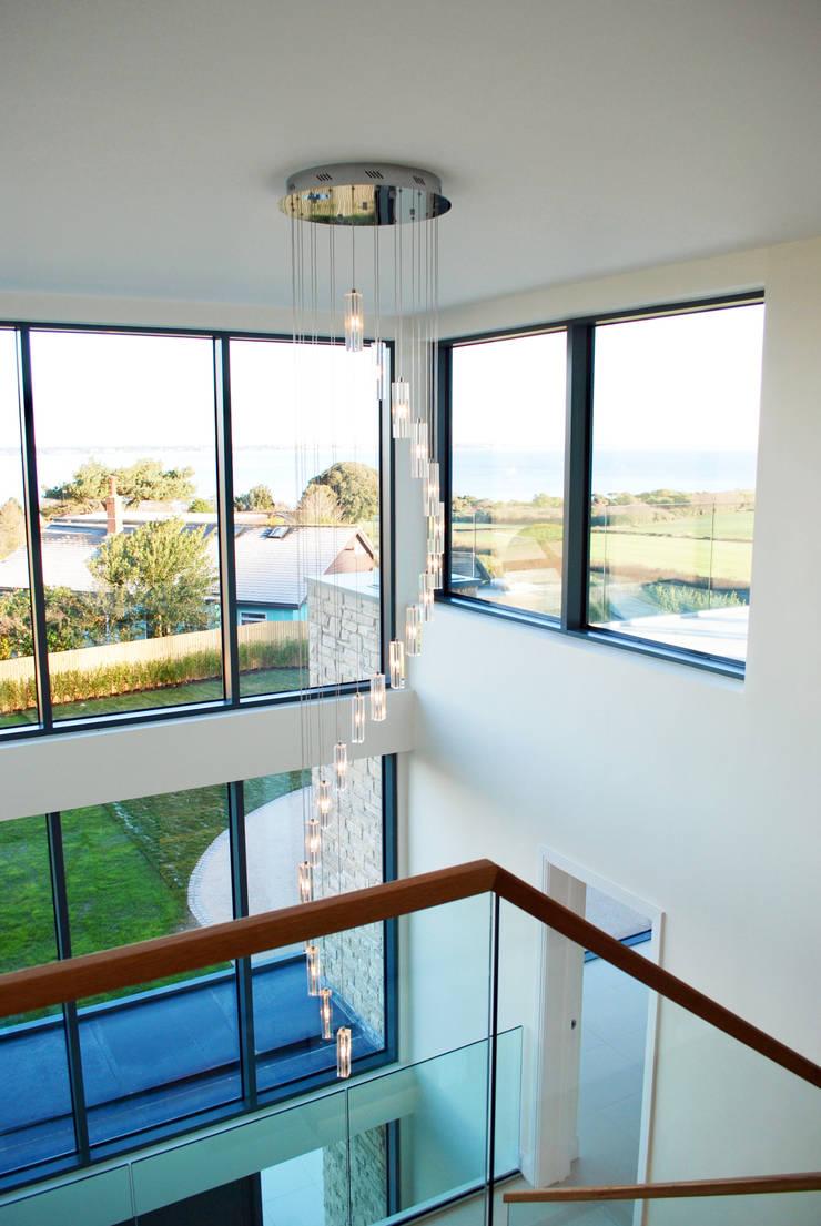 Escaleras de estilo  por David James Architects & Partners Ltd,