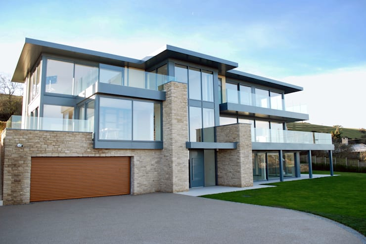 Casas de estilo  por David James Architects & Partners Ltd,