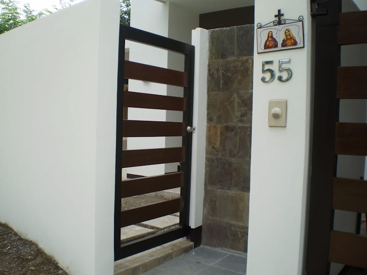 Gate of Reconstructed HC-Residence:  Front doors by KDA Design + Architecture