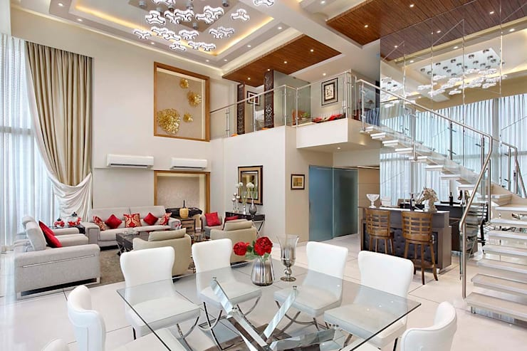 Sand Dunes Pent House :  Dining room by Mahesh Punjabi Associates