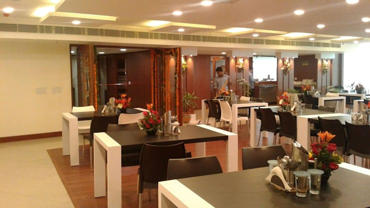 Cafeteria Design for HPCL at Scope Minar Office: modern  by HOME CITY LIFESTYLE,Modern Solid Wood Multicolored