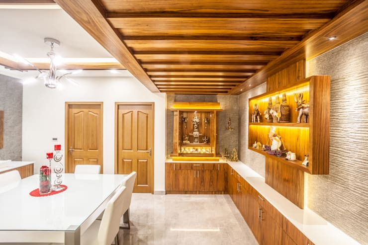 The mural apartment: asian Dining room by S Squared Architects Pvt Ltd.