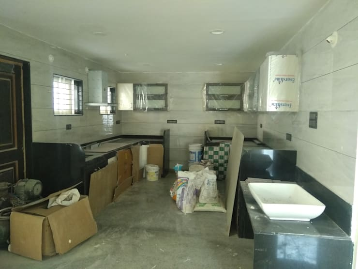 Modern kitchen:  Kitchen units by Cfolios Design And Construction Solutions Pvt Ltd,Modern