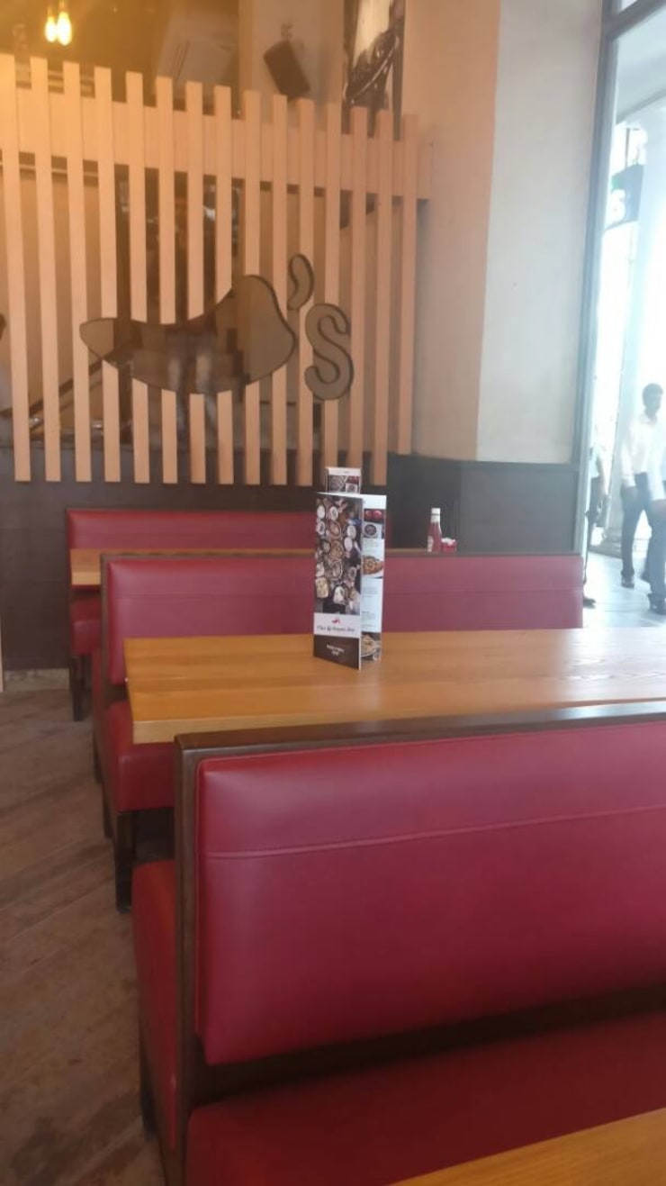 Chili's, Connaught Place:  Dining room by HOME CITY LIFESTYLE