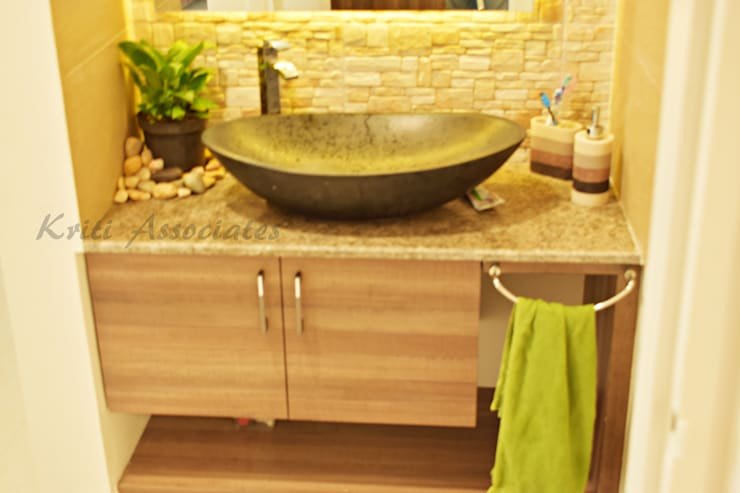 3bhk Home at Godrej Horizon: rustic Bathroom by Kriti Associates / girishsdesigns