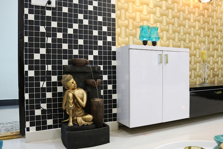 Budha Water fountain:  Living room by Enrich Interiors & Decors
