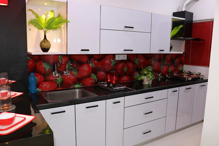 Modular Kitchen with Customized Backsplash Color Glass:  Kitchen units by Enrich Interiors & Decors