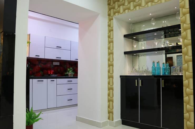 Mini Bar Zone:  Wine cellar by Enrich Interiors & Decors