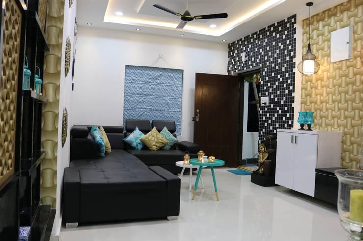 L Shape Sofa:  Living room by Enrich Interiors & Decors