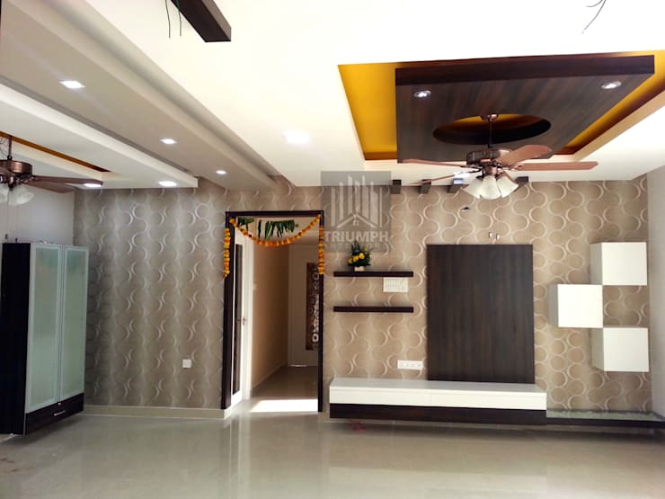 Living room T.V stands and false ceiling : classic Living room by TRIUMPH INTERIORS