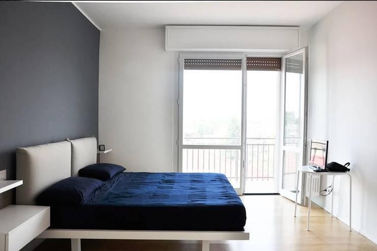 Appartamento in città Camera da letto moderna di atelier architettura Moderno