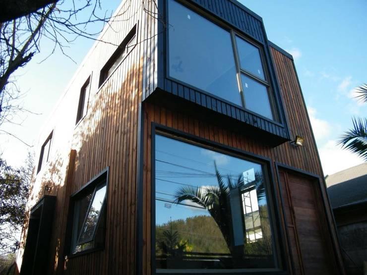CUCA HOUSE: Casas de estilo  por Manuel Herrera