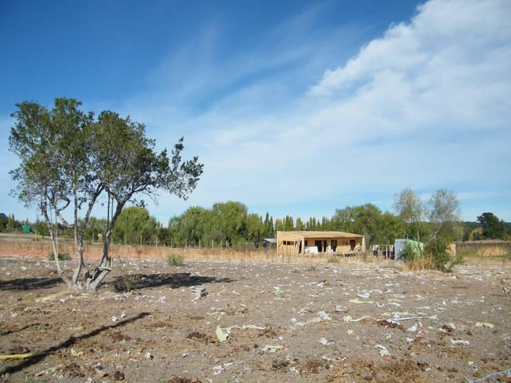 4 16 HOUSE: Casas de madera de estilo  por Manuel Herrera