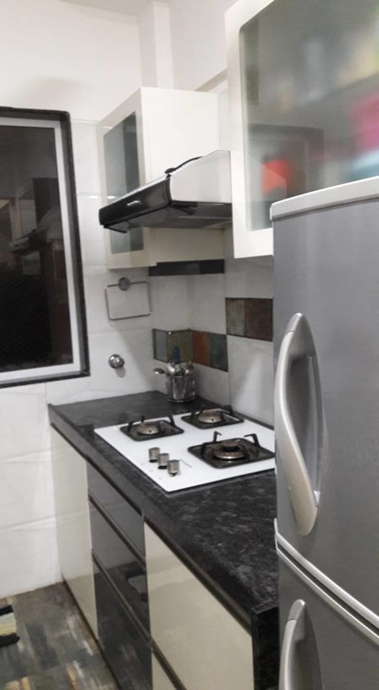 2bhk Residential project  :  Kitchen units by Interiqo