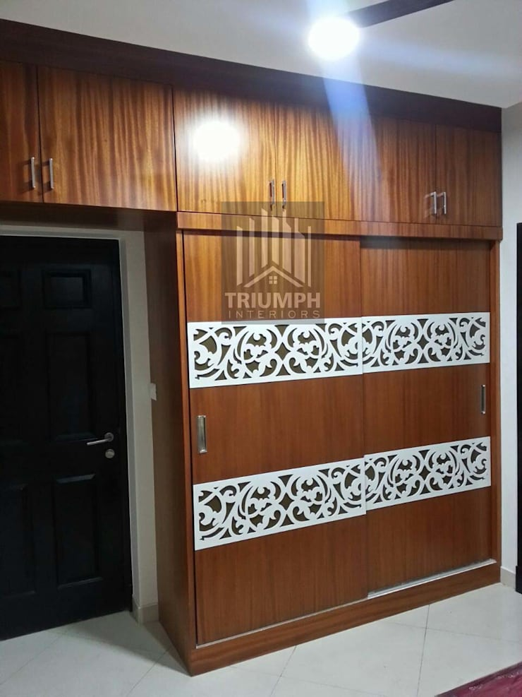 Master Bed room Wardrobe:  Bedroom by TRIUMPH INTERIORS