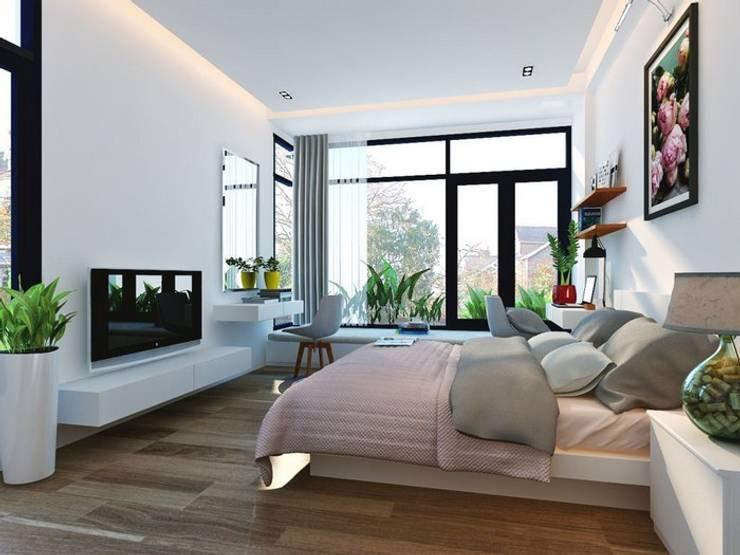 Ốp sàn gỗ với màu sắc mang hiệu ứng so le nhau tạo cảm giác không gian rộng thêm.:  Phòng ngủ by Công ty TNHH Thiết Kế Xây Dựng Song Phát
