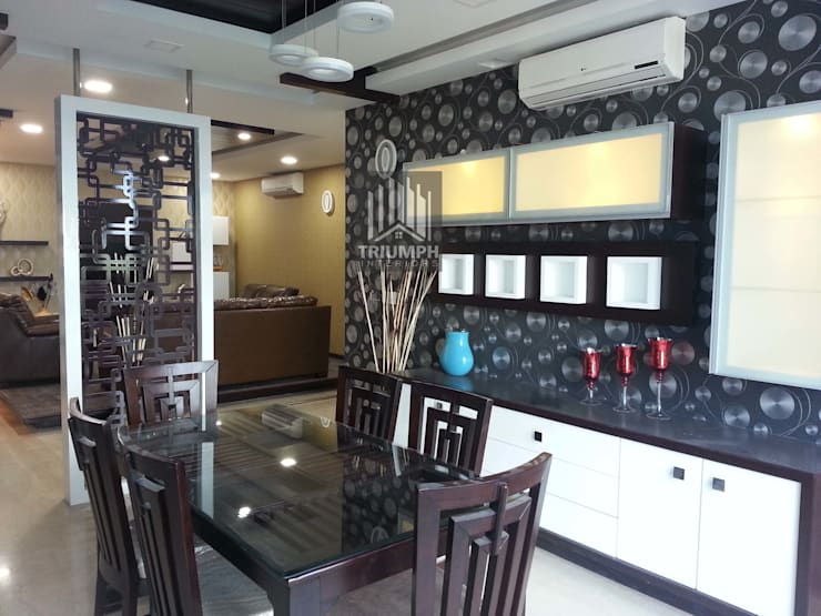 Dinning Area: modern Dining room by TRIUMPH INTERIORS
