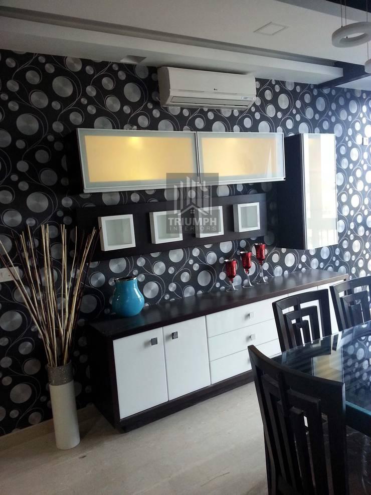 Display & Crockery: modern Dining room by TRIUMPH INTERIORS