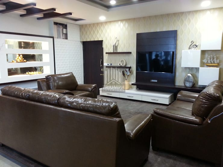 T.V Unit & False Ceiling: modern Living room by TRIUMPH INTERIORS