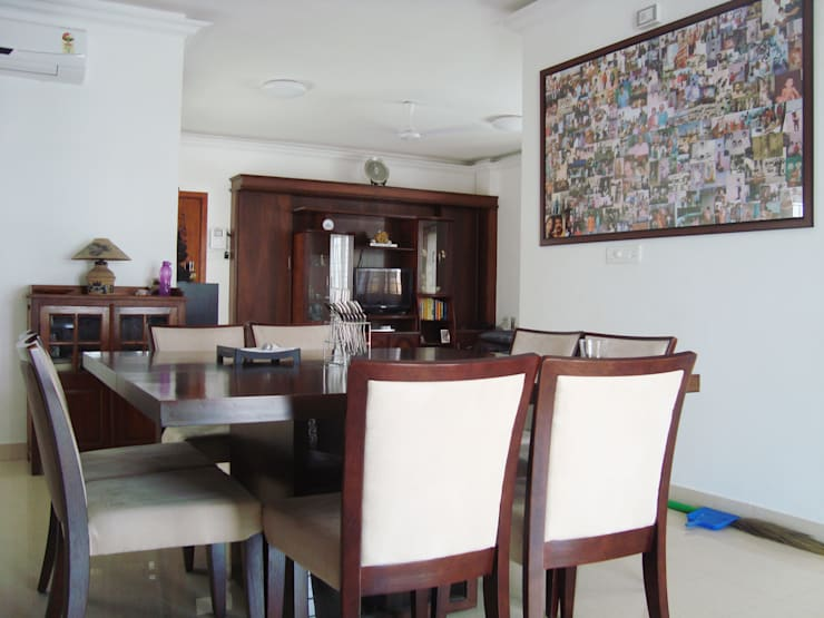 RESIDENT INTERIOR: classic Dining room by Inshows Displays Private Limited