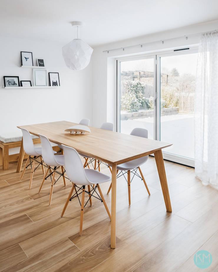 Scandinavian style dining:  Dining room by Katie Malik Interiors