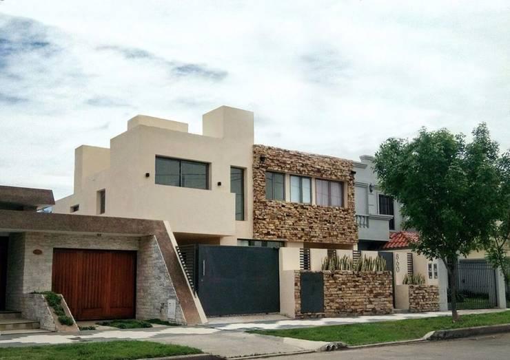 PROYECTO FINAL: VIVIENDA MULTIFAMILIAR WG: Casas multifamiliares de estilo  por PRIGIONI Arquitectura y Diseño,