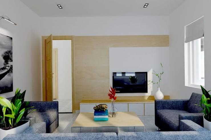 Gam màu trắng chủ đạo đem lại hiệu ứng ánh sáng tích cực cho những căn nhà phố.:  Phòng khách by Công ty TNHH Thiết Kế Xây Dựng Song Phát