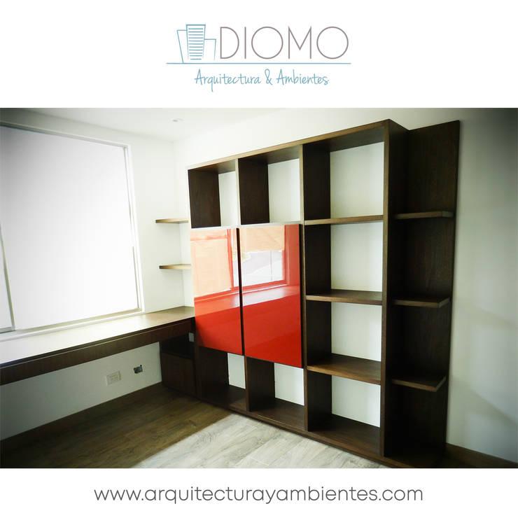 Biblioteca: Hogar de estilo  por Diomo Arquitectura y Ambientes