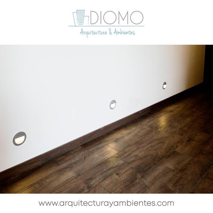 Pisos: Salones de estilo  por Diomo Arquitectura y Ambientes