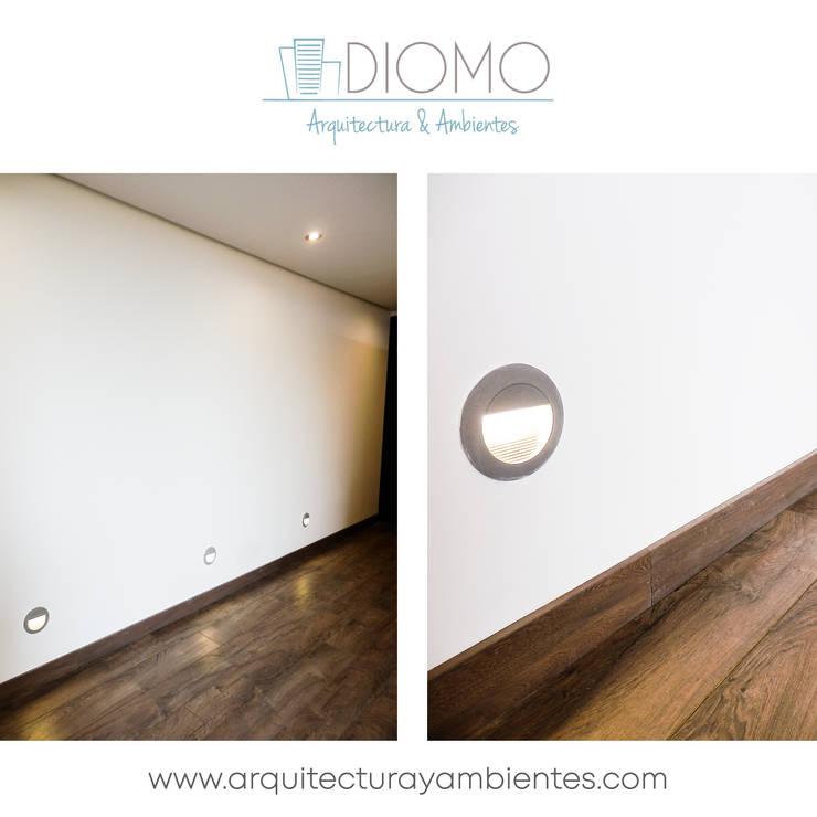 Pisos: Hogar de estilo  por Diomo Arquitectura y Ambientes