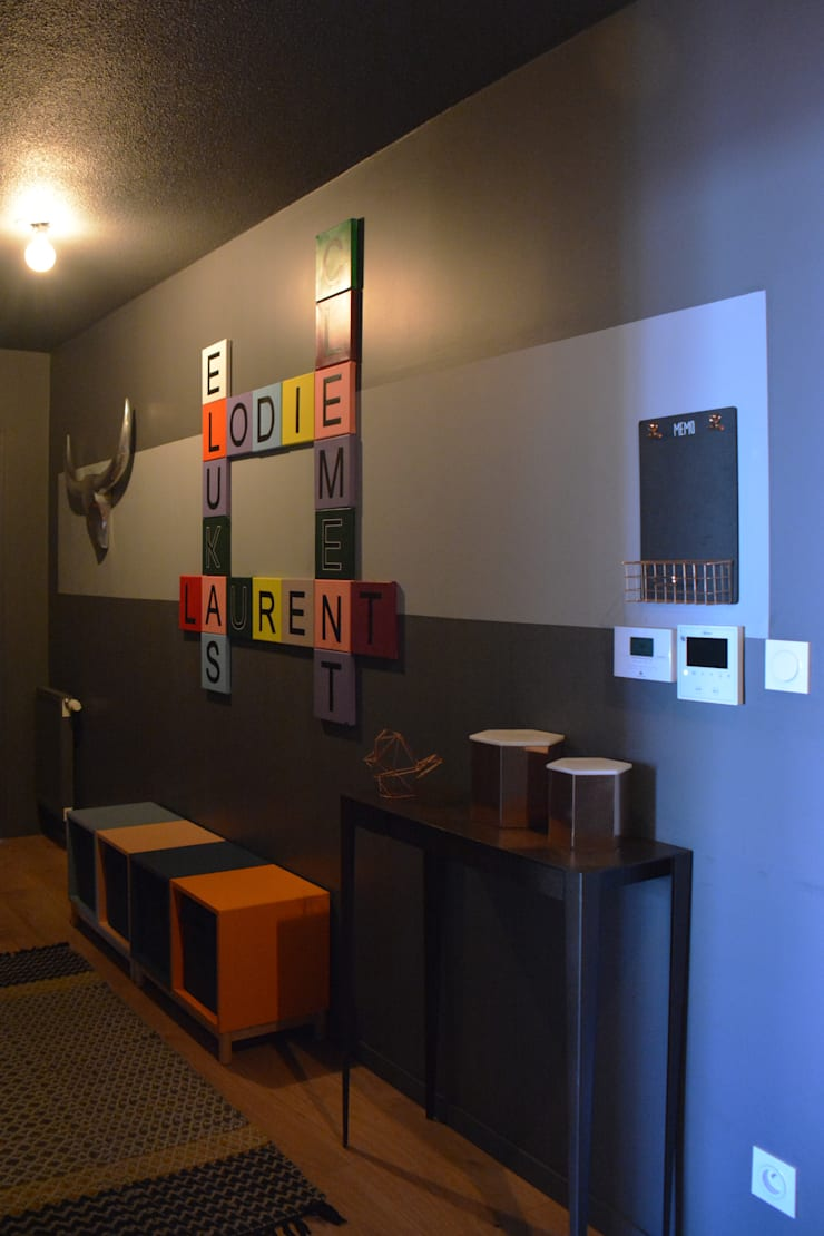 Décoration d'un appartement neuf à Lyon: Couloir et hall d'entrée de style  par Koya Architecture Intérieure