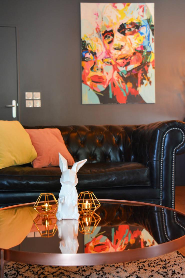 Décoration d'un appartement neuf à Lyon: Salon de style  par Koya Architecture Intérieure