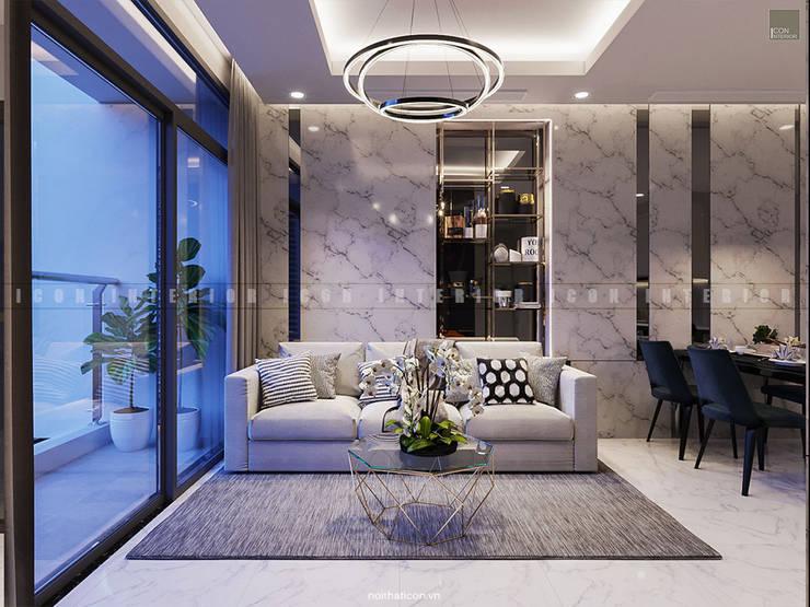 SẮC TRẮNG TRONG CĂN HỘ CHUNG CƯ CAO CẤP VINHOMES CENTRAL PARK:  Phòng khách by ICON INTERIOR