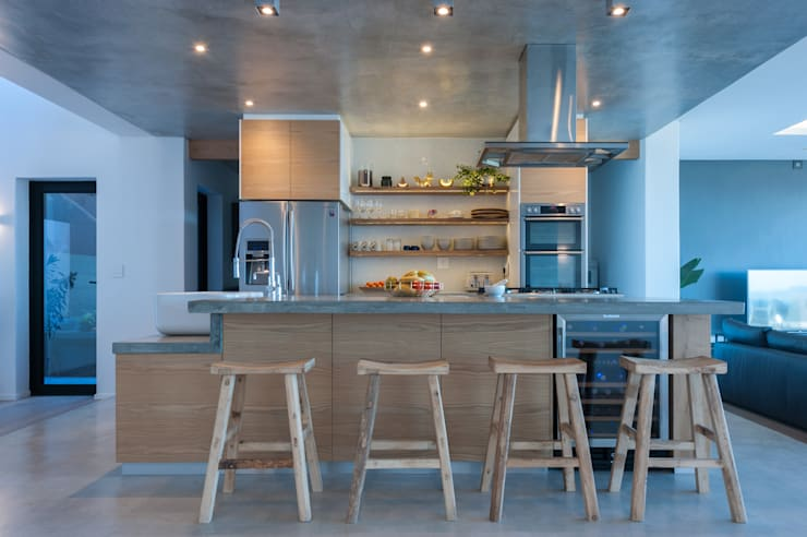 Oak kitchen with concrete tops:  Kitchen units by JBA Architects, Modern Wood Wood effect
