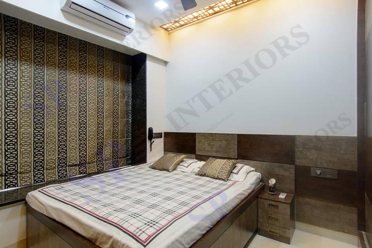 Bhadresh Jhaveri:  Bedroom by SP INTERIORS