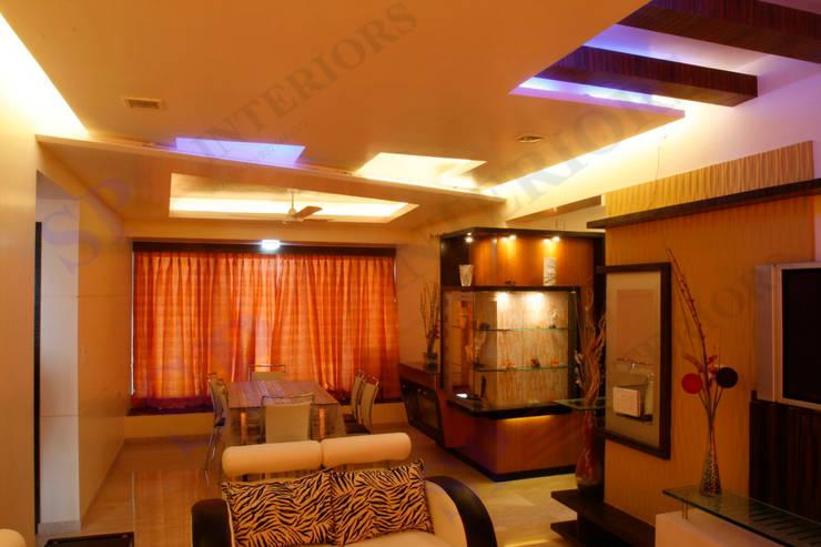 DR Rahul Hegde:  Living room by SP INTERIORS,Modern