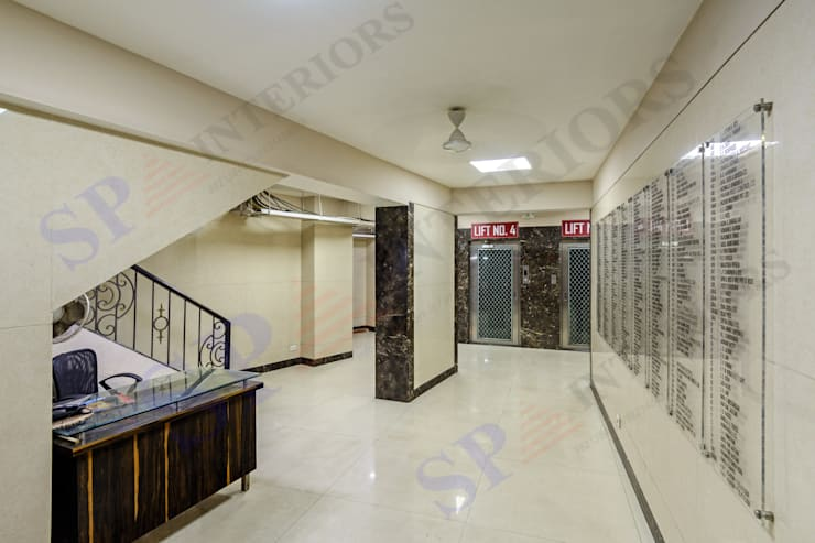 Navjeevan Commercial bldg. 2 wings:  Office buildings by SP INTERIORS,Modern