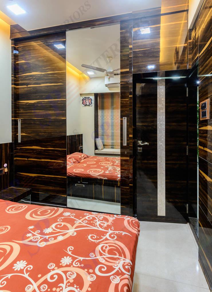 VarunJhaveri: modern Bedroom by SP INTERIORS