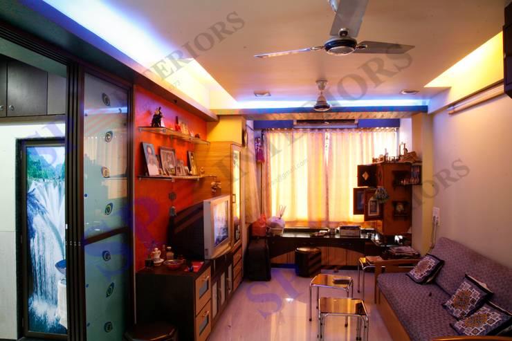Shahil Bhai:  Living room by SP INTERIORS,Modern