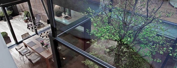 Гостиная в . Автор – Cluster Architekten / Inkognito