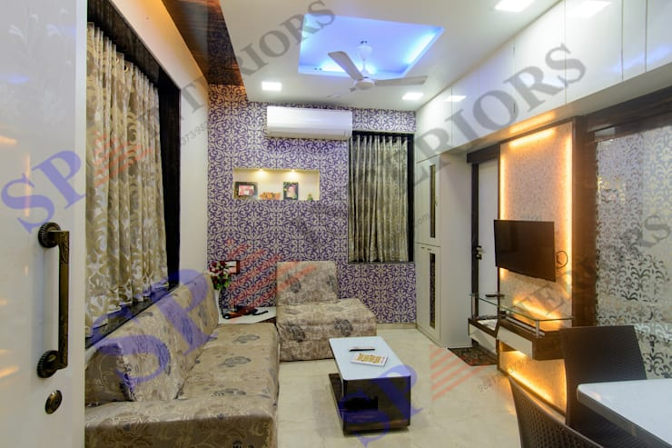 Ritesh bhai: modern Living room by SP INTERIORS