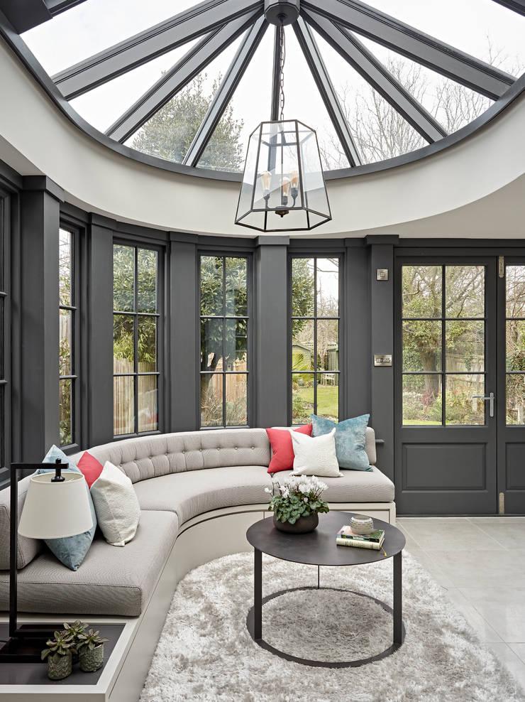 Зимние сады в . Автор – Tailored Living Interiors, Модерн Дерево Эффект древесины