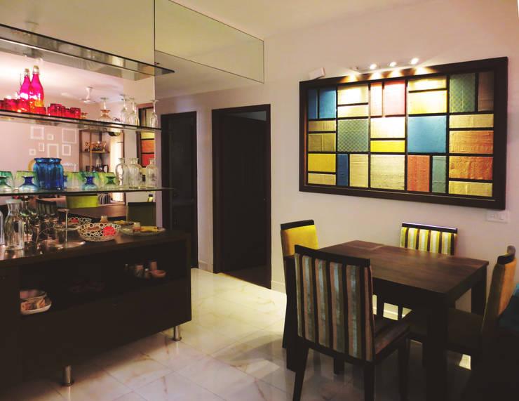 GITANJALI RESIDENCE:  Dining room by CARTWHEEL,Modern